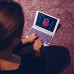 Female woman typing on locked smart device pad attacked by ransomware virus